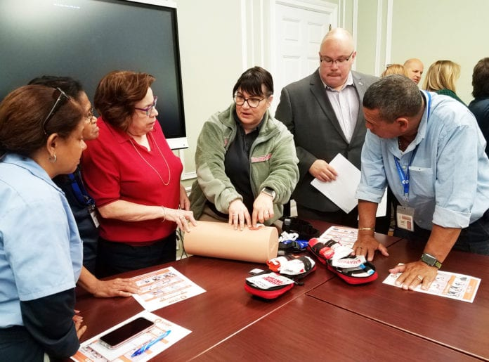 A representative from the Nassau County Fire-Police EMS Academy demonstrates life-saving bleeding control strategies during a recent training workshop as part of the Stop the Bleed initiative. (Photo courtesy of Great Neck Public Schools)