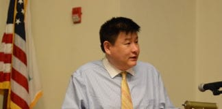 James Wu, as seen here at a Meet the Candidates event in May, said the candidate swap was necessary and not a first in the village. (Photo by Janelle Clausen)