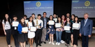 Robert Zahn and award-winning students from GNPS/TV are congratulated by musician Meredith O'Connor and Rene Fiechter, an assistant district attorney and the director of community affairs at an awards ceremony on June 4. (Photo by Anna Zahn)