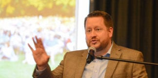 Austin Hochstetler, a senior project manager with PROS Consulting, outlines the firm's findings about the Great Neck Park District. (Photo by Janelle Clausen)