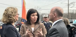 Nassau County District Attorney Madeline Singas of Manhasset, center, speaks with Nassau County Executive Laura Curran and Nassau County Police Commissioner Patrick Ryder after a press conference in 2018 about opioid overdoses. (Photo by Amelia Camurati)