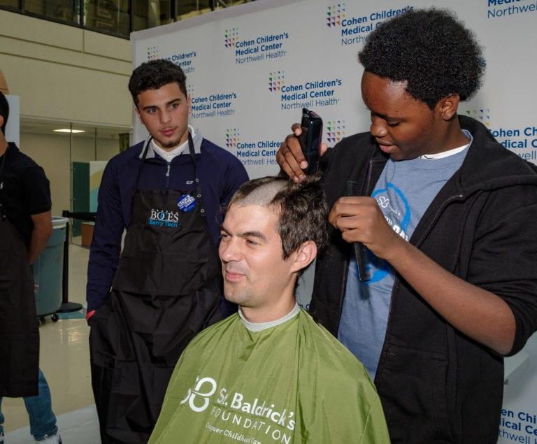 Hospital big-wigs go bald for St. Baldrick's Day at Cohen Children's