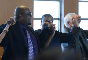 "Attendees joined hands to form a ""circle of love"" as they sang ""We Shall Overcome"" together. (Photo by Janelle Clausen)"